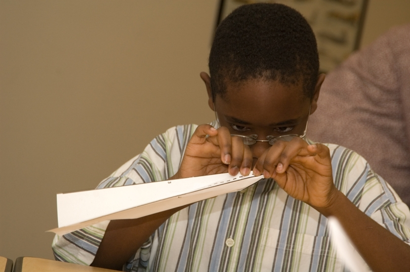 Boy-with-Paper-Airplane