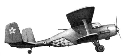The An-2F of 1948, was an experimental artillery-oservation model of 1948. Check out the  with glazed fuselage section, dorsal machine-gun position and twin vertical tail surfaces.
