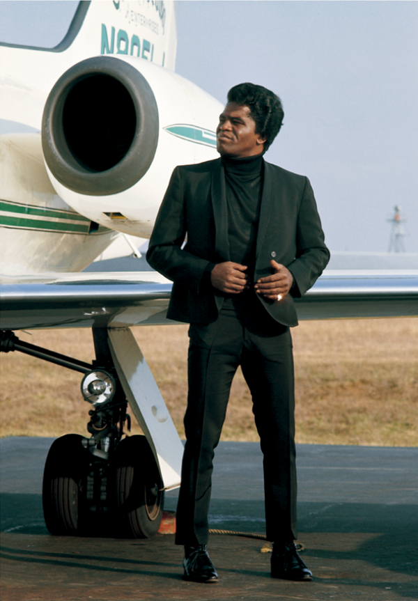 James Brown with a plane; can you identify the type?