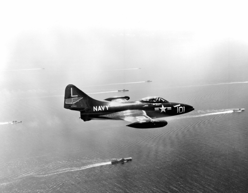 F9F attached to the USS BON HOMME RICHARD (CVA31) flies over task force 77 engaged in 3 carrier operations against North Korean targets.  The carriers are USS BON HOMME RICHARD (CVA31) USS ESSEX (CVA9) and the USS PRINCETON (CVA37). NARA FILE #:  80-G-480645
