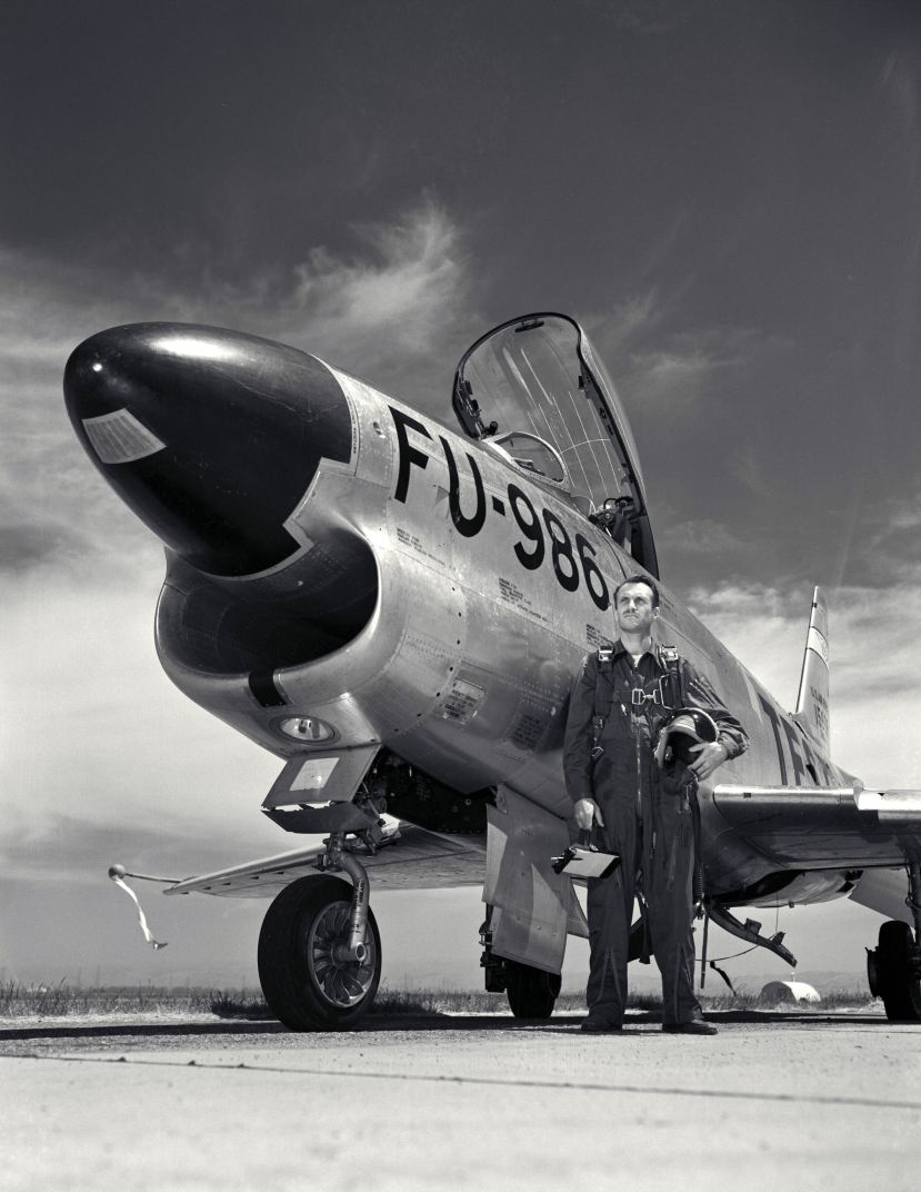 naca-test-pilot-george-cooper-stand-in-front-of-the-f-100-1954