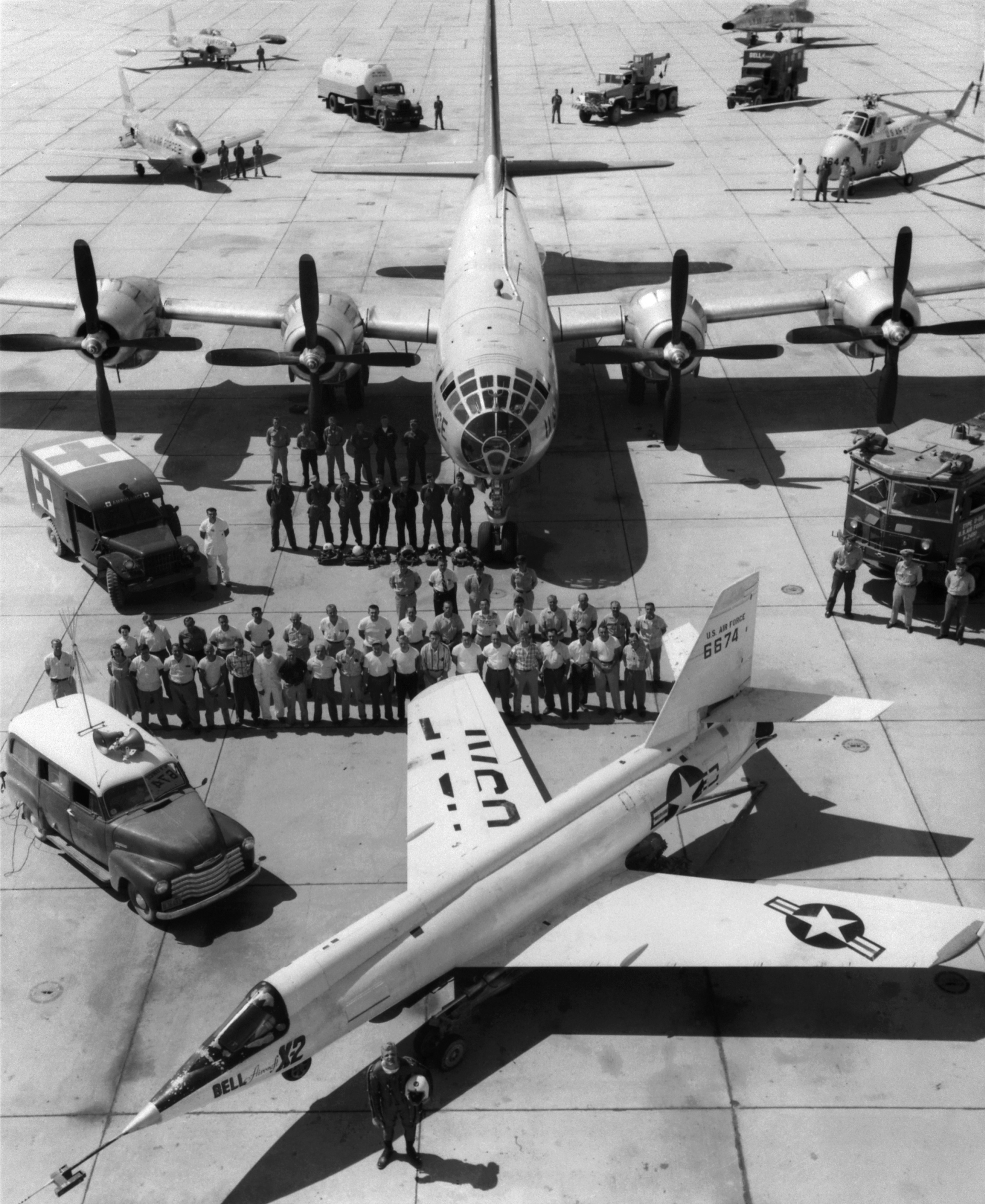 X-2_on_ramp_with_B-50_mothership_and_support_crew.jpg