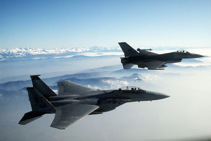 An air-to-air right side view of a 50th Tactical Fighter Wing F-16A Fighting Falcon aircraft in formation with a 36th Tactical Fighter Wing F-15D Eagle aircraft during a dissimilar aircraft combat tactics exercise.