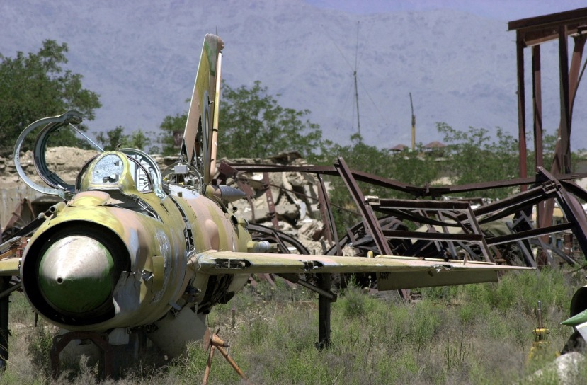 The wreckage of an abandoned Soviet Mig-21 Fishbed aircraft sits with rusted hardware in an open field near Bagram Air Base, Afghanistan, during Operation ENDURING FREEDOM. After over 20 years of war and civil unrest, the Afghan landscape is painted with pieces of old military hardware and unexploded ordnance.