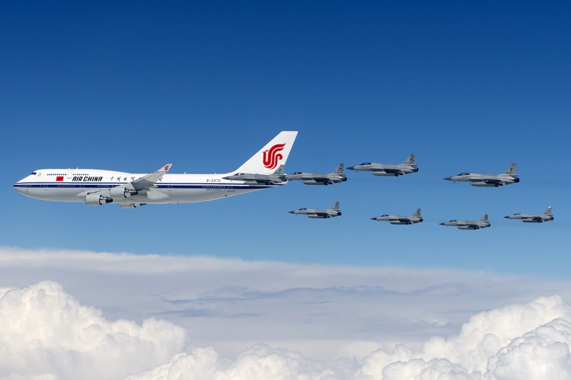 Eight_Pakistan_Air_Force_JF-17s_escort_Air_China_Boeing_747-400.jpg