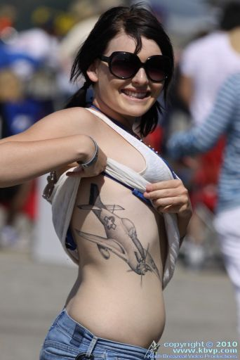 Girl Shows Off Her P 51 Mustang Tattoo Preview Hush Kit