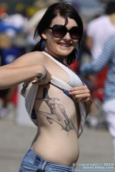 Girl Shows Off Her P-51 Mustang Tattoo.preview