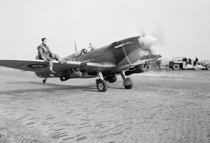 A_Supermarine_Spitfire_Mk_IXE_of_No._412_Squadron_RCAF,_armed_with_a_250-lb_GP_bomb_under_each_wing,_taxies_out_for_a_sortie_at_Volkel,_Holland,_27_October_1944._CL1451.jpg
