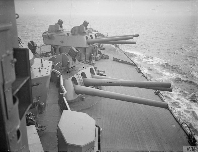 16_inch_gun_turrets_and_Unrotated_Projectile_launchers_on_HMS_Nelson_1940_IWM_A_1994.jpg