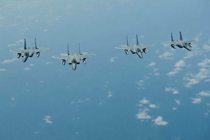 2560px-Four_F-15C_Eagles_fly_in_formation_off_the_coast_of_Japan_(25896707120).jpg