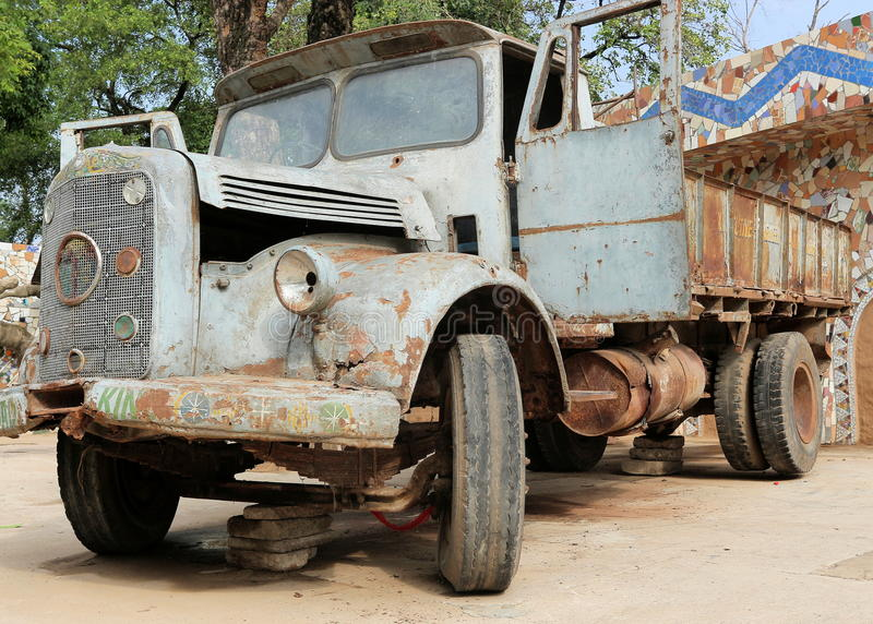 vintage-antique-rusty-decaying-damaged-old-pickup-truck-tata-rock-garden-chandigarh-india-96364504