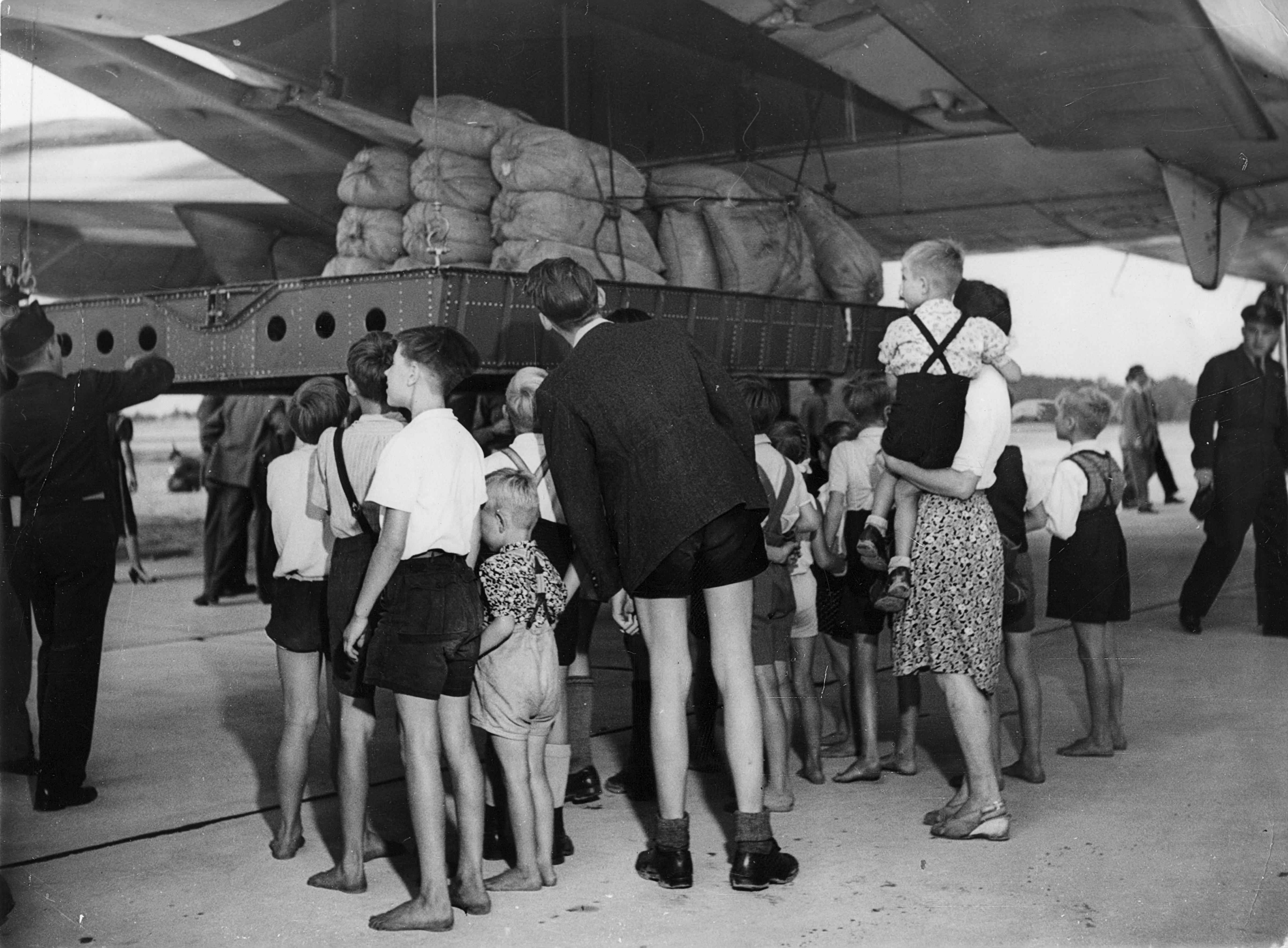 C-74_Globemaster_unloading_flour_at_Berlin_Gatow_during_Operation_Vittles.jpg