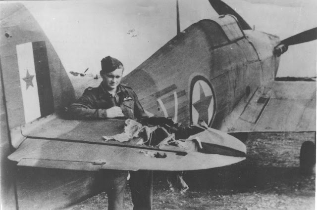 Yugoslavian pilot Tugomir Prebeg stands by his Hawker Hurricane damaged during a ground attack mission in 1944.jpg